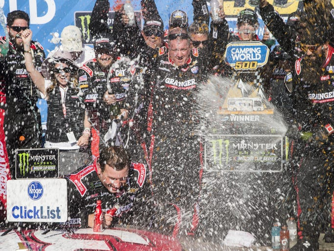 Ryan Newman celebrates with his team after winning