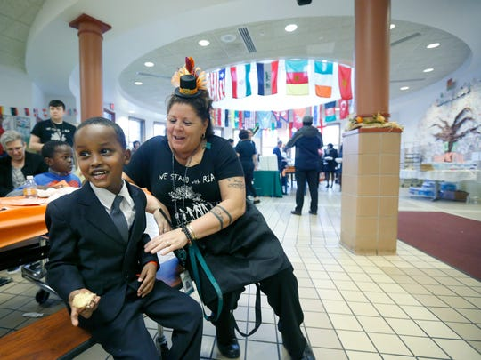 School principal Mary Andrecolich Montesano Diaz jokes around with Yasin Hassan, 6, of Rochester during ÒAn American Celebration Ð Thanksgiving DinnerÓ at the Rochester International Academy. This was the seventh annual Thanksgiving celebration for the schoolÕs students, families, and community partners.