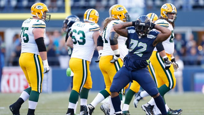 Seattle Seahawks defensive end Michael Bennett (72) celebrates after a play during the first quarter against the Green Bay Packers at CenturyLink Field.