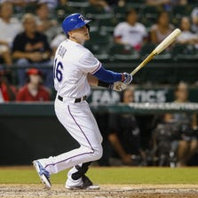 Sep 9, 2014; Arlington, TX, USA; Texas Rangers first baseman Ryan Rua (16) hits a two-run double during the eighth inning against the Los Angeles Angels at Globe Life Park in Arlington. Mandatory Credit: Kevin Jairaj-USA TODAY Sports