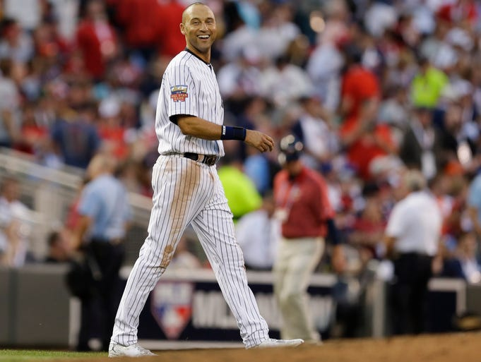 American League shortstop Derek Jeter, of the New York Yankees, walks to short stop during the third inning of the MLB All-Star baseball game, Tuesday, July 15, 2014, in Minneapolis. (AP Photo/Jeff Roberson)