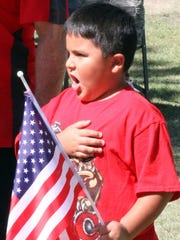 """Nathaniel Ponce, 6, led the audience in the """"Pledge"""