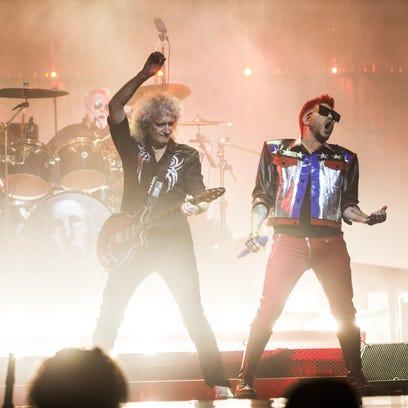 Queen guitarist Brian May plays as Adam Lambert rocks
