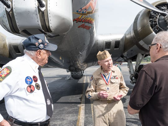 World War II veterans and Montville residents Gerald Gemian, 95, and Hjalmar Johansson, 92, chat before boarding a vintage World War II B-17 for a flight out of Caldwell-Essex Airport in Fairfield.