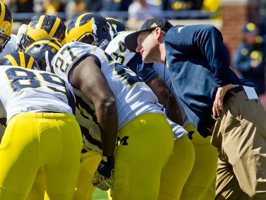 635742947002835459-AP-Michigan-Spring-Game-Foot