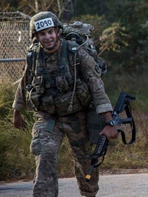 Major Kenneth M. Reed Jr., approaching the finish line of the 12-mile road march, the final event in the Expert Field Medical Badge testing.