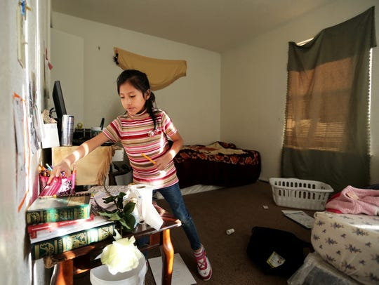 Yury Escalante, 7, gathers supplies for her homework
