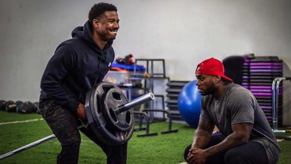 Michael B. Jordan, left, works out with his personal