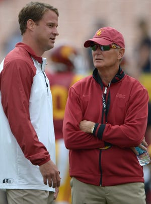 USC athletic director Pat Haden, right, with coach Lane Kiffin.