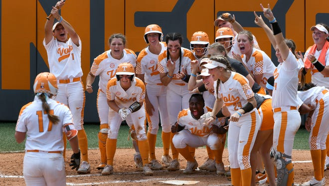 Lady Vols celebrate an over the fence homer by Chelsea Seggern in their game against James Madison in the NCAA Softball Tournament at Sherry Parker Lee Stadium Saturday, May 19, 2018.