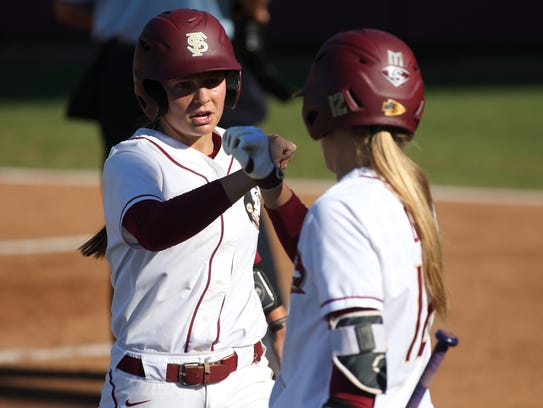 FSU's Cali Harrod, left, is congratulated by teammate