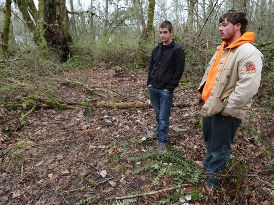 Gabriel Fromherz, center, of Salem and Robert Ready of Independence stand near the exact spot where they found a red Toyota Prius in the brush on Jan. 30. Behind the wheel were the remains of Daniel Zwicker, who had been missing for nearly a year and a half. Photographed on Friday, Feb. 26, 2016.