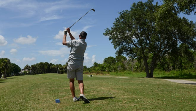 Corey Kramer tees off on one of the holes at The Savannahs Golf Club in Merritt Island in July.