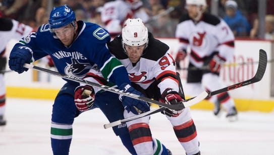 Vancouver Canucks left wing Sven Baertschi (47) fights