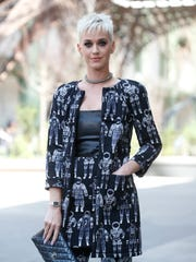 Singer Katy Perry poses for photographers at the Chanel