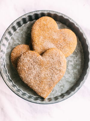 Cinnamon Heart Grahams from C. Adam's Bakery are coated in cinnamon sugar before baking.