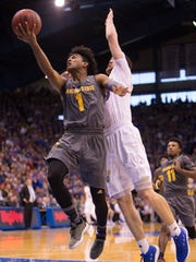 Arizona State's Remy Martin goes in for a layup against