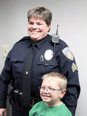 Becky Ervin, pictured with son Cameron, is Fairfield's newest sergeant.