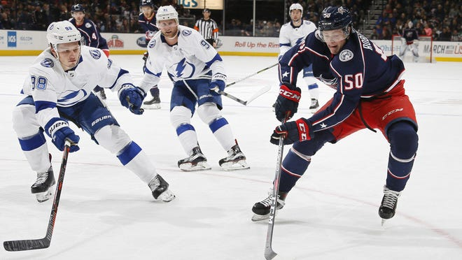 """Forward Eric Robinson, right, """"has that top-tier speed in this league and when he uses it, he's a weapon,"""" said Blue Jackets captain Nick Foligno."""
