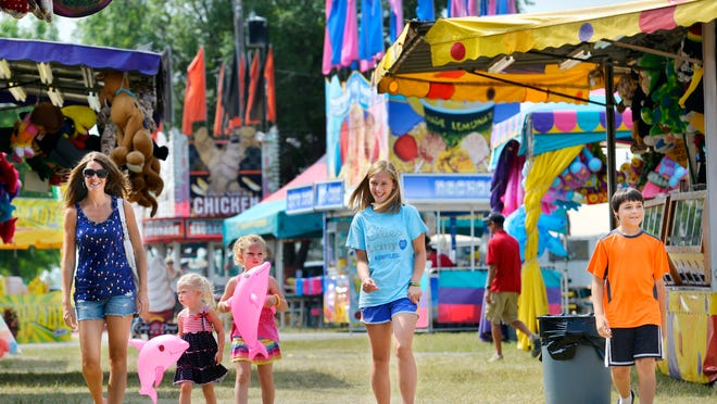 Courtney Backes (from left), her children Aubree and Macey, and family friends Katelyn Zimmer and Koye Zellner take in the sights of the Stearns County Fair Friday in Sauk Centre.