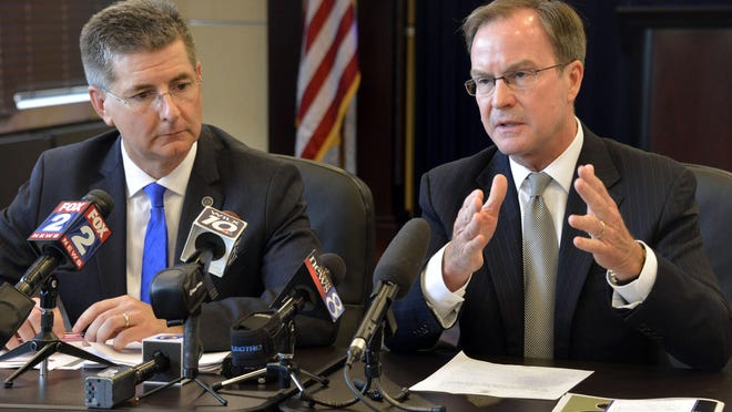 Michigan Attorney General Bill Schuette holds a news conference with Michigan DEQ director Dan Wyant, left, to talk about pipeline restrictions on Tuesday, July 14, 2015 in Lansing.