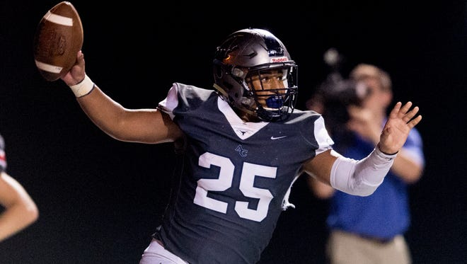 Anderson County's Marquise Gallahar (25) reacts after making a touchdown during a game between Anderson County and Heritage at Anderson County High School in city}, Tennessee on Friday, September 22, 2017.