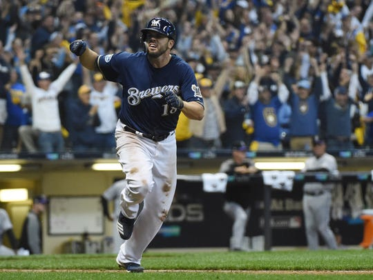 A jubilant Mike Moustakas of the Brewers runs to first