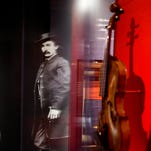 "A large photograph depicting President Abraham Lincoln's assassin John Wilkes Booth is displayed at a new exhibit titled ""Silent Witnesses: Artifacts of the Lincoln Assassination"" at the Ford's Center for Education and Leadership across the street from the historic Ford's Theatre, on Tuesday in Washington."