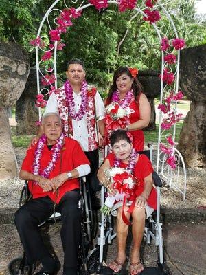 """Grandson Benny Joshua """"BJ"""" Parr and grandmother Beatrice L.G. Cruz celebrate their joint wedding ceremony with their family on May 6, 2017."""