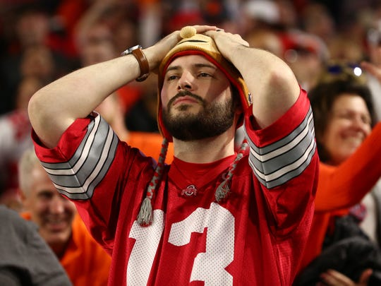 An Ohio State fan reacts after a Clemson interception during the third quarter of the College Football Playoff Semifinal game in the PlayStation Fiesta Bowl on Dec. 31, 2016 at University of Phoenix Stadium in Glendale, Arizona.