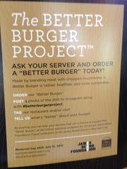 A sign explaining the #betterburgerproject greets customers at The Cider Press Cafe in Naples.