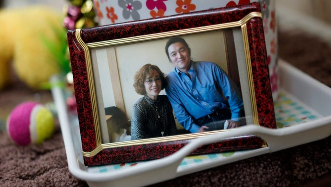 A framed photograph of Junko Ishido, left, and her son Kenji Goto.