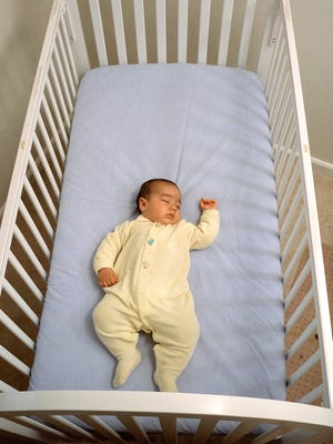 This photo illustrates a safe sleep environment for a baby, in which the risks of Sudden Infant Death Syndrome (SIDS) and other sleep-related causes of infant death are low. Baby is sleeping on its back on a firm sleep surface; and there are no crib bumpers, pillows, blankets, loose bedding, or toys are in the sleep area.
