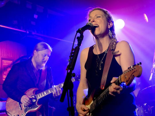Recording artists Derek Trucks and Susan Tedeschi of Tedeschi Trucks Band perform at John Varvatos Bowery NYC on January 31, 2014 in New York, New York.