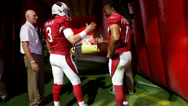 Arizona Cardinals quarterback Carson Palmer and receiver Larry Fitzgerald.