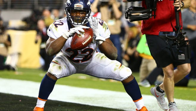Denver Broncos running back C.J. Anderson (22) celebrates after scoring a fourth quarter touchdown against the Carolina Panthers in Super Bowl 50 at Levi's Stadium.