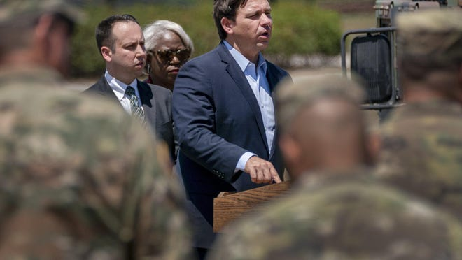 Governor Ron DeSantis speaks at a news conference next to Palm Beach County Mayor Dave Kerner and County Administrator Verdenia Baker at a drive-through COVID-19 testing location at the FITTEAM Ballpark of The Palm Beaches on March 30, 2020 in West Palm Beach, Florida