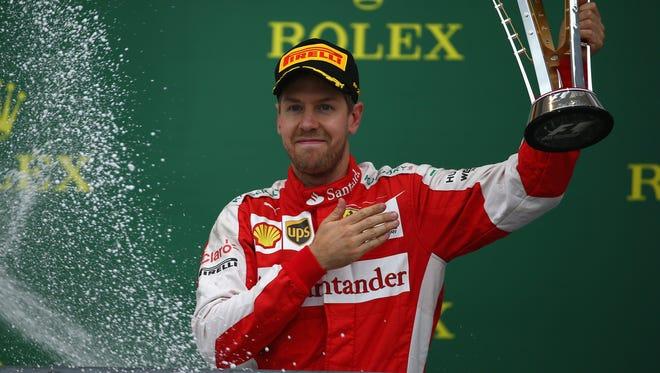 Sebastian Vettel celebrates on the podium after finishing third in Sunday's United States Grand Prix.