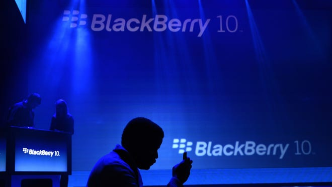 In this January 30, 2013 file photo, members of the media attend the unveiling of the BlackBerry 10 mobile platformand new devices in New York City.  BlackBerry said November 30, 2015 it is exiting Pakistan rather than hand over its customers' private messages, after the government demanded access to encrypted data sent through company servers. AFP/Getty Images