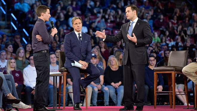 This Feb. 21 photo shows Marjory Stoneman Douglas High School student Cameron Kasky, left, asking a question to Sen. Marco Rubio during a CNN town hall meeting in Sunrise, Fla.