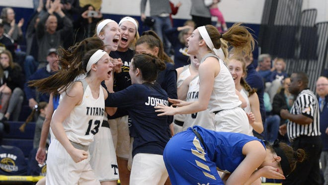 Webster Schroeder's Emily Willis-Nersinger, right, covers her face as Webster Thomas players celebrate their win in a Class AA sectional quarterfinal at Webster Thomas High School, Sunday, Feb. 25, 2018. No. 2 seed Webster Thomas beat No.7 seed Webster Schroeder 54-52.