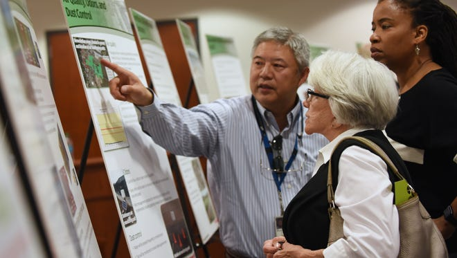 Richard Ho of the Environmental Protection Agency in discussion with Edgewater resident Irene Stella and Natalie Loney, EPA community involvement coordinator, in Edgewater on Tuesday. The session was held to answer questions about the upcoming Quanta Superfund site cleanup.