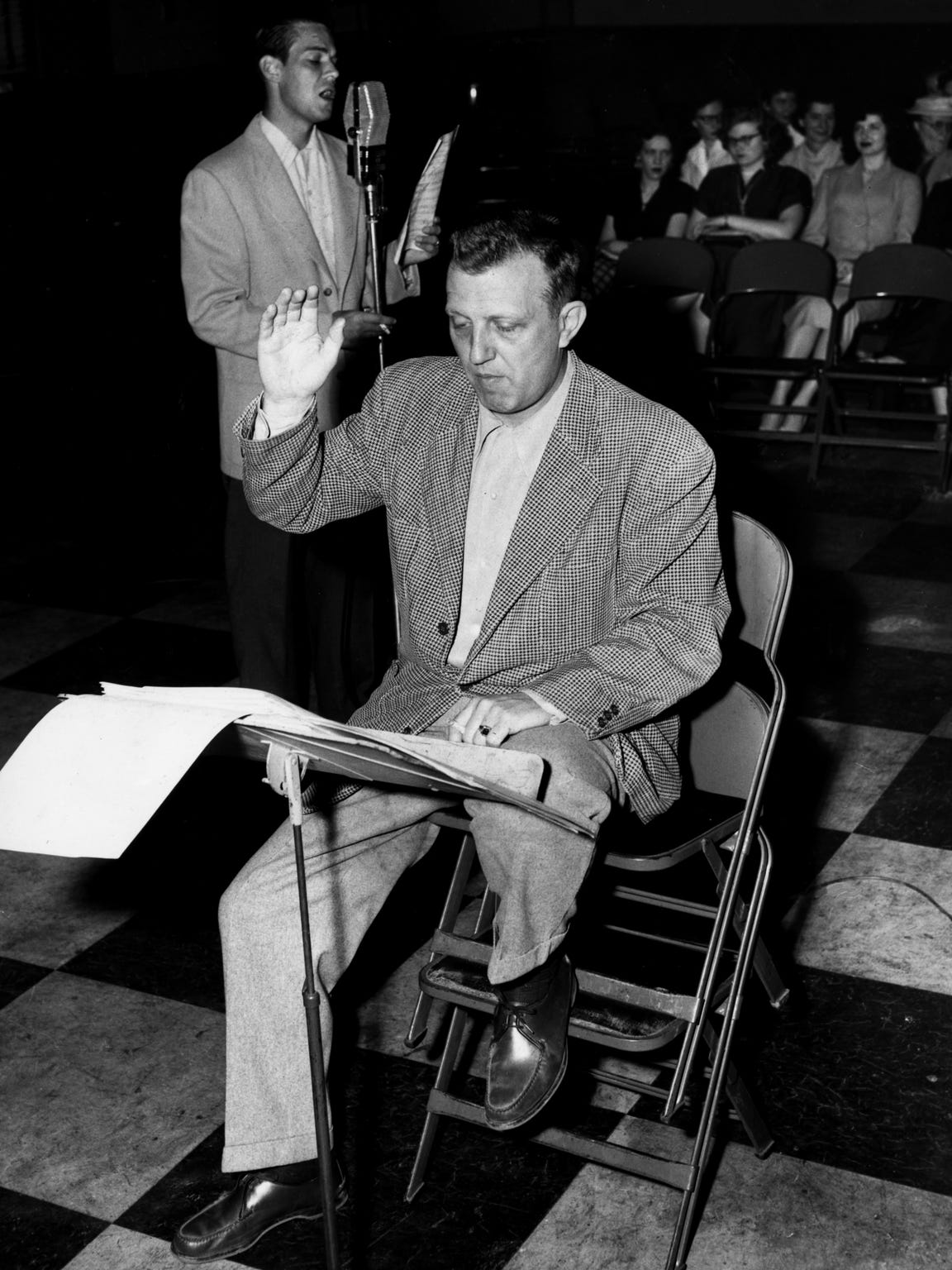 Owen Bradley, front, leads a singer in the studio in 1957, a year after he knocks out a floor of an old house and brings the first music enterprise to what would become Music Row.