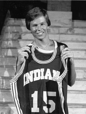 Ann Meyers, the first woman ever asked to try out for an NBA basketball team, holds up her Pacers jersey with the number 15 on it on Sept. 6 1979.