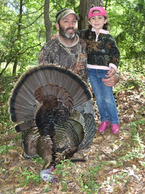 Hunters like Justin Brown of Florence and his daughter Brylee Brown, 3, have a chance to win a one-of-a-kind turkey call from Pittman Game Calls in the Beards and Spurs Photo Contest.