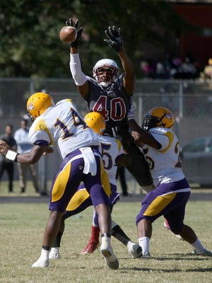 Lane College defensive lineman Whitney Richardson (40) blocks a pass from Benedict College quarterback Phillip Brown (14) at Lane Field in Jackson, Tenn., on Saturday, Oct. 8, 2016.