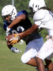 Blackman's Adonis Otey fakes a hands off to Master