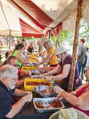 Volunteers prepare fresh local strawberries for the Beacon Sloop Club's annual festival in this file photo.
