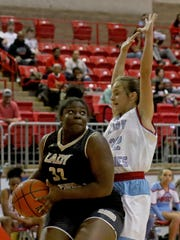 Rider's Keyshawna Newman drives to the basket while