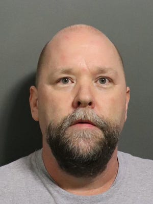 This undated photo provided by the Douglas County Sheriff's Office shows Shawn O'Brien. University of Kansas authorities who have been investigating O'Brien, a massage therapist who had connections to women's sports programs, said Tuesday that their investigation so far has found inappropriate behavior including unwanted touching during massages with at least six female athletes.